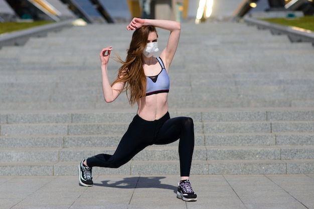 Woman runners morning exercise she wears a nose mask. protection against dust and viruses, covid
