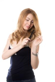 Woman running her comb through her hair