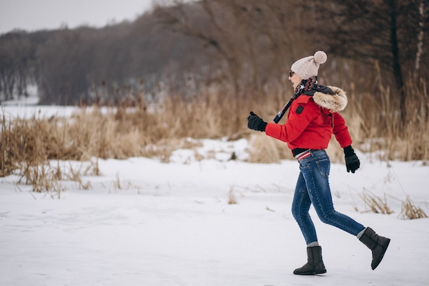 Woman running on lake in winter