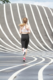 Woman running at superkilen parc in copenhagen