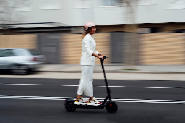 Woman running with electric scooter in the city