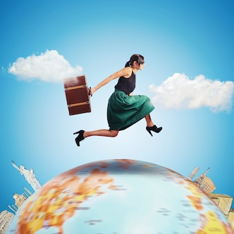 Woman runs with a suitcase over the world
