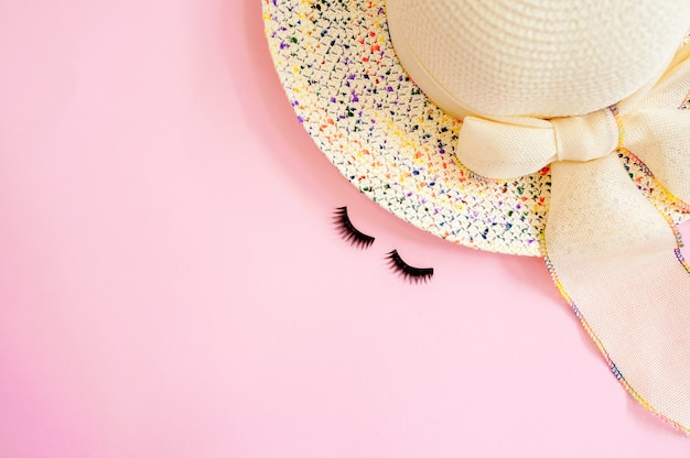 Woman's accessories flat lay on colorful background. top view. blue and yellow pastel colors with copy space around products. horizontal image or photograph.