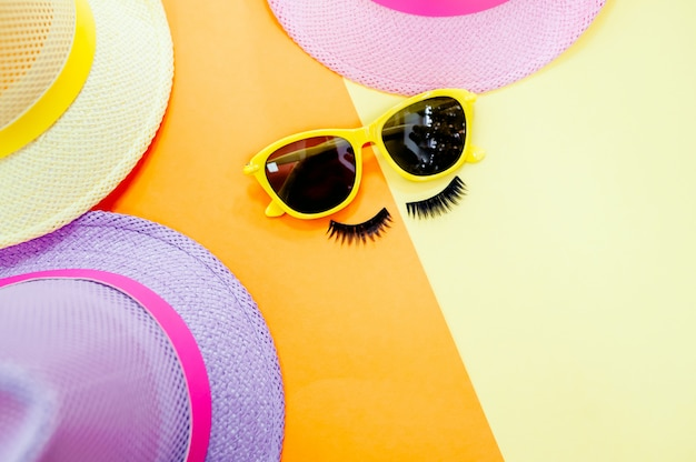 Woman's accessories lying flat on textured fabric background. blue and yellow pastel colors.