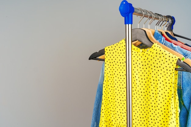 Woman's colorful different clothes on hanger  close up