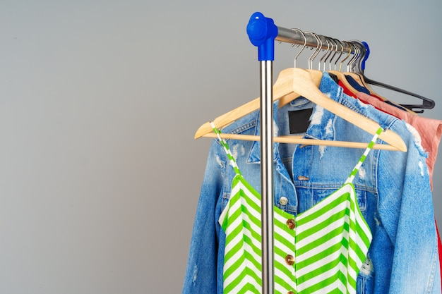 Woman's colorful different clothes on hanger