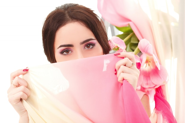 Woman's face covered with handkerchief
