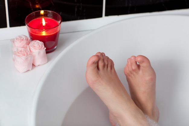 Woman's feet in a bath