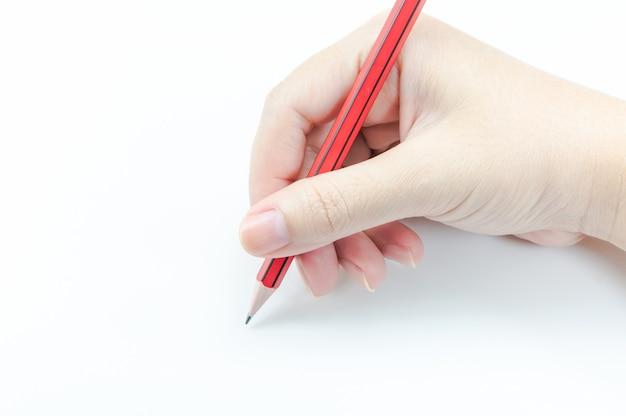 白地に赤鉛筆を持つ女性の手