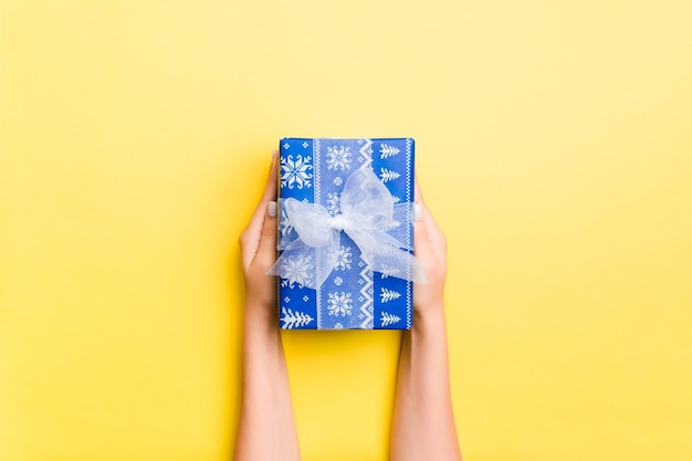 Woman's hand holding a christmas gift