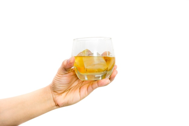 Woman's hand holding a glass of wine with ices.