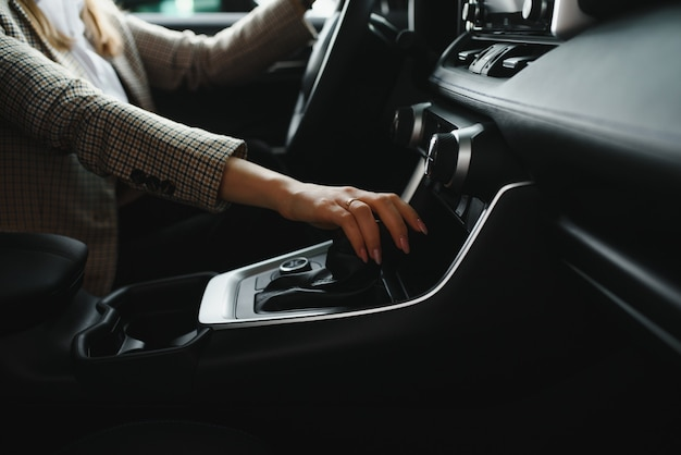 Woman's hand is about to drive into gear ,selective focus on hand