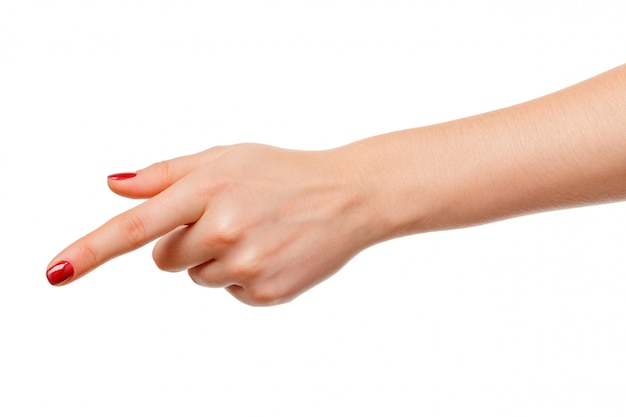 Woman's hand points a finger at something isolated on white background