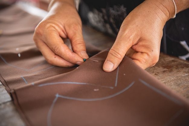 Woman's hand sewing fabric with sewing equipments