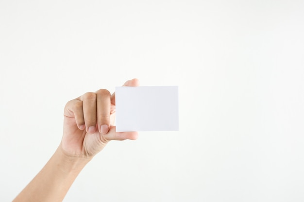 Woman's hand showing white paper  on white background.