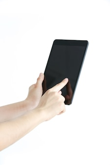 Woman's hand touching a black tablet