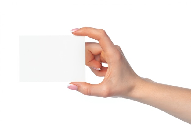 Woman's hand with blank white business card isolated on white