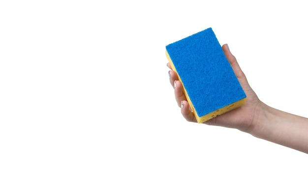A woman's hand with a blue washcloth sponge isolated on a white surface