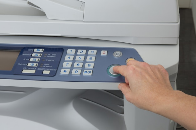 Woman's hand with working copier isolated