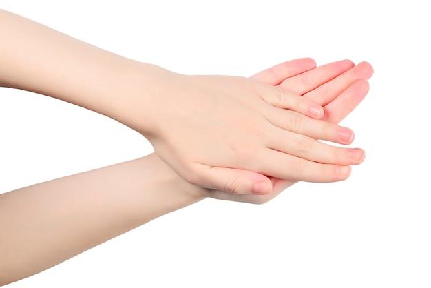 흰색 표면에 고립 된 여자의 손 박수 패턴