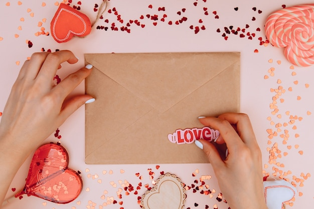 Woman's hands holding a letter in craft envelope
