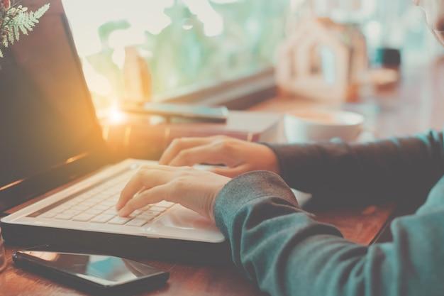 Woman's hands using laptop computer working