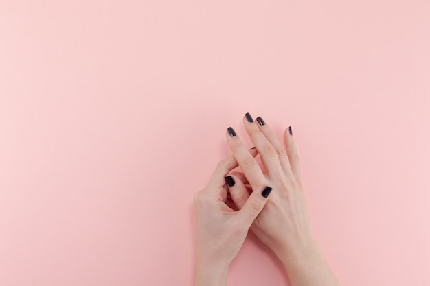 Woman's hands with black manicure