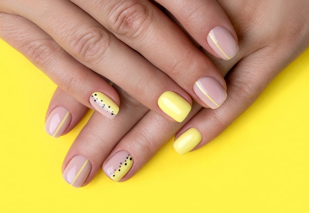 Woman's hands with spring summer nail design