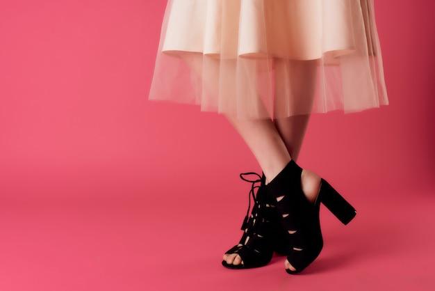 Woman's legs in black high heels
