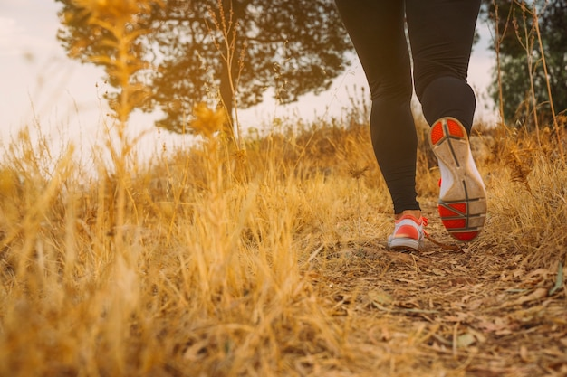 Woman's legs running in the morning