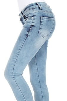 Woman's legs with blue denim on white background