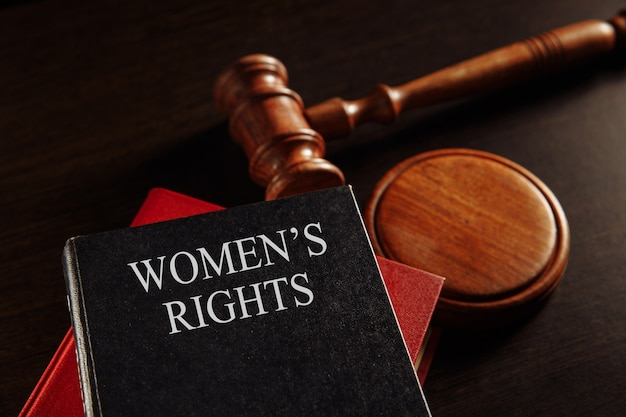 Woman's rights book at the desk.
