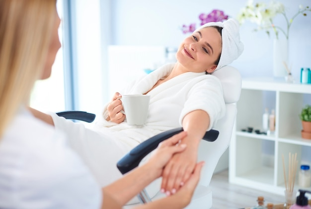Woman at salon getting her manicure