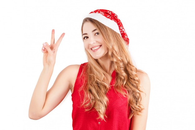 Woman in santa hat isolated on white.