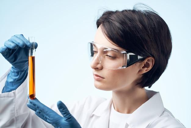 Woman scientist laboratory research analyzes diagnostics