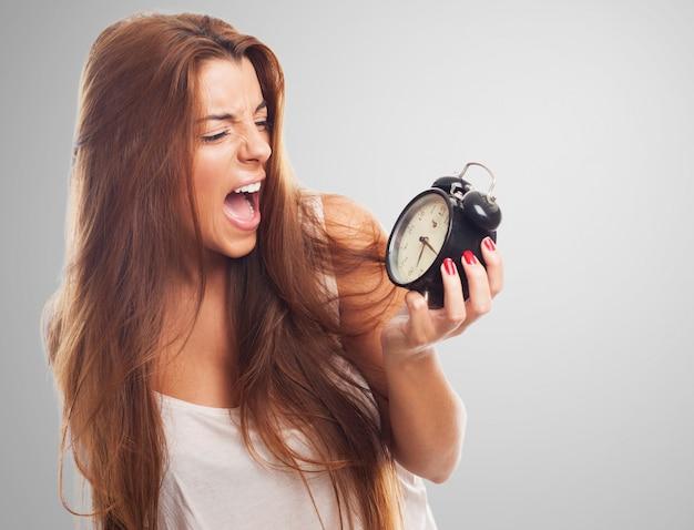 Woman screaming at alarm clock
