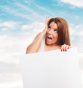 Woman screaming looking up
