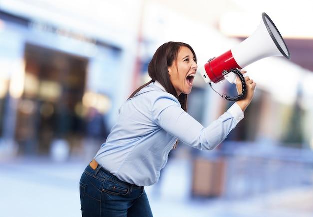 Woman screaming through a megaphone