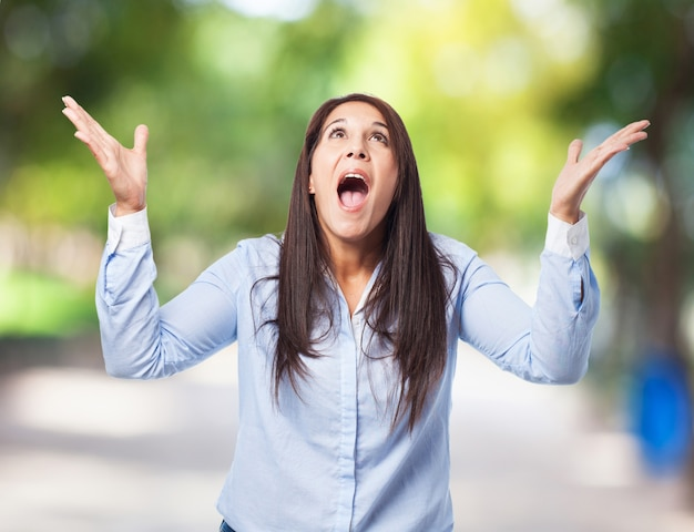 Woman screaming with hands up