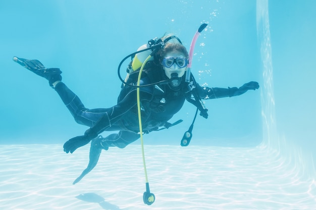 Woman on scuba training submerged in swimming pool