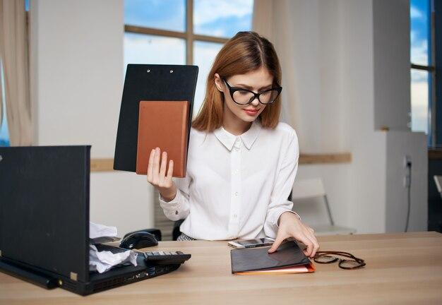 Woman secretary office work laptop professional