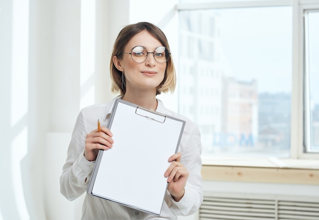 Woman secretary in white shirt folder for papers copy-space office. high quality photo