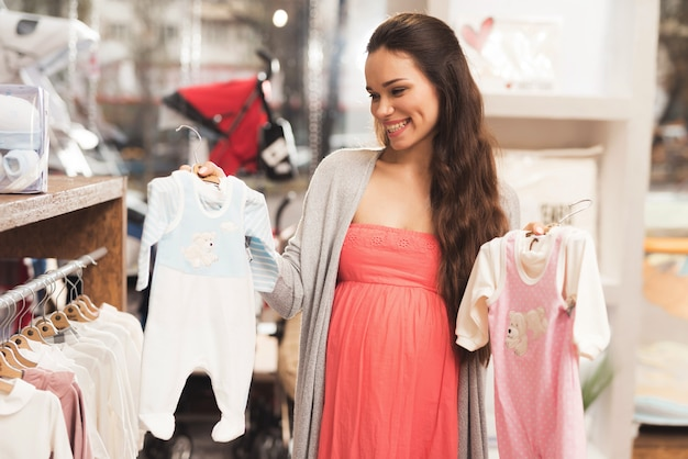 Woman selection clothes for young children.