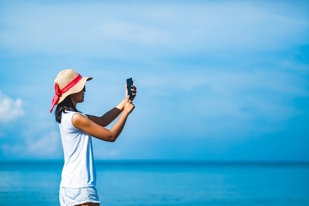 Woman selfie on beach