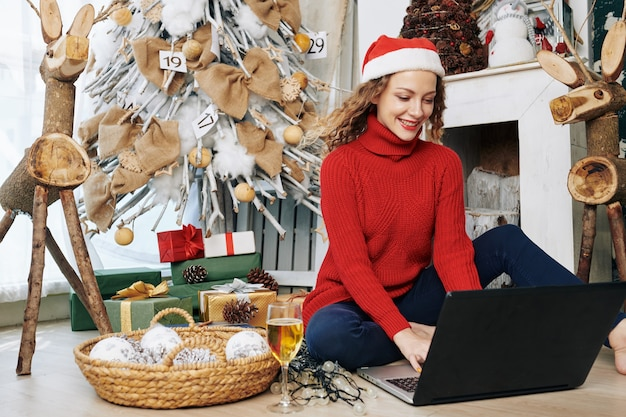 Woman sending e-mails on christmas