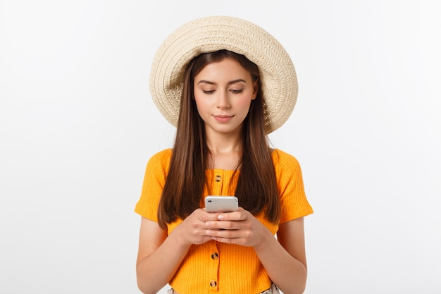Woman sending a sms on cell phone