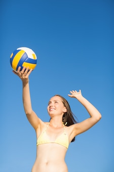 Woman serve at a volley ball match