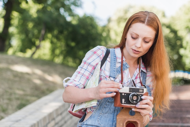 Woman setting up camera in park