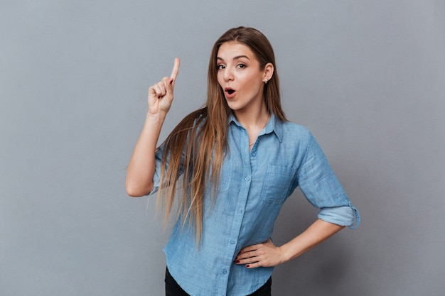 Woman in shirt showing attention sign