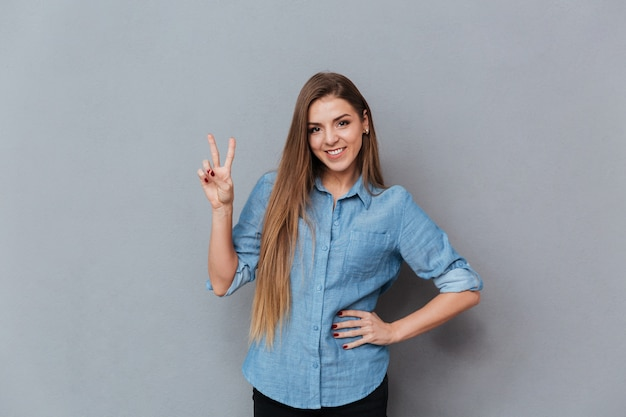 Woman in shirt showing peace sign
